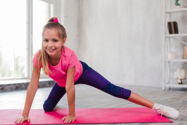 smiling-portrait-blonde-girl-exercising-pink-mat_23-2148186455