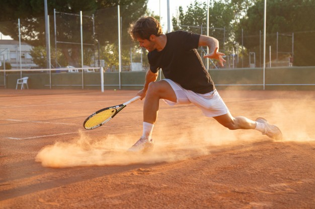 professional-tennis-player-man-playing-court-afternoon_127519-4